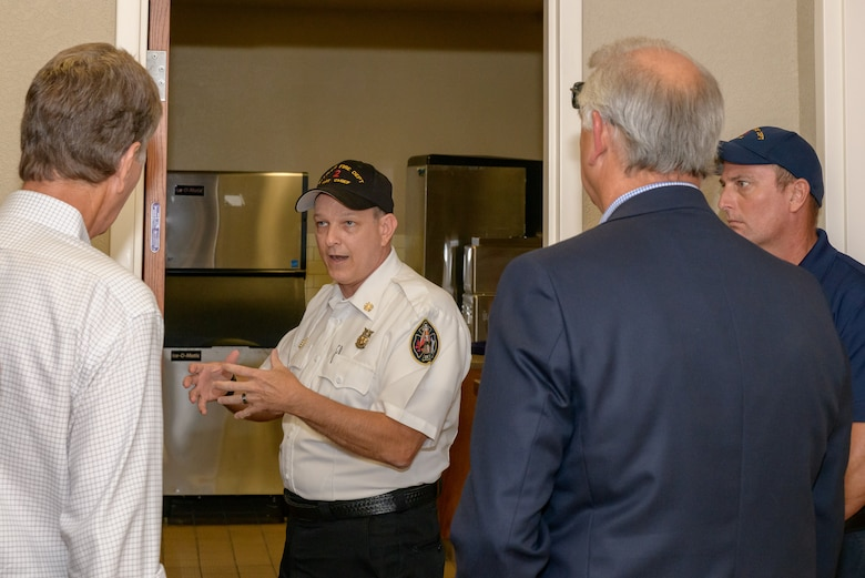 Chief James Donnett, 81st Infrastructure Division fire chief gives a brief on Fire Emergency Services during the 81st Mission Support Group Honorary Commanders tour at the Fire Department at Keesler Air Force Base, Mississippi, Aug. 23, 2018. The honorary commander program is a partnership between base leadership and local civic leaders to promote strong ties between military and civilian leaders. (U.S. Air Force Photo by Andre' Askew)