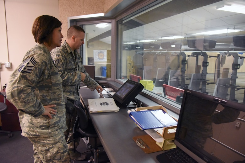 Staff Sgt. Derek Gioia, 81st Security Forces Squadron combat arms instructor, demonstrates the capabilities of the 81st SFS indoor firing range for Chief Master Sgt. JoAnne Bass, 2nd Air Force command chief, during an immersion tour on Keesler Air Force Base, Mississippi, Aug. 23, 2018. Bass's one-day tour also included the Keesler Medical Center, 81st Training Group and Wing Staff Agency. (U.S. Air Force photo by Kemberly Groue)