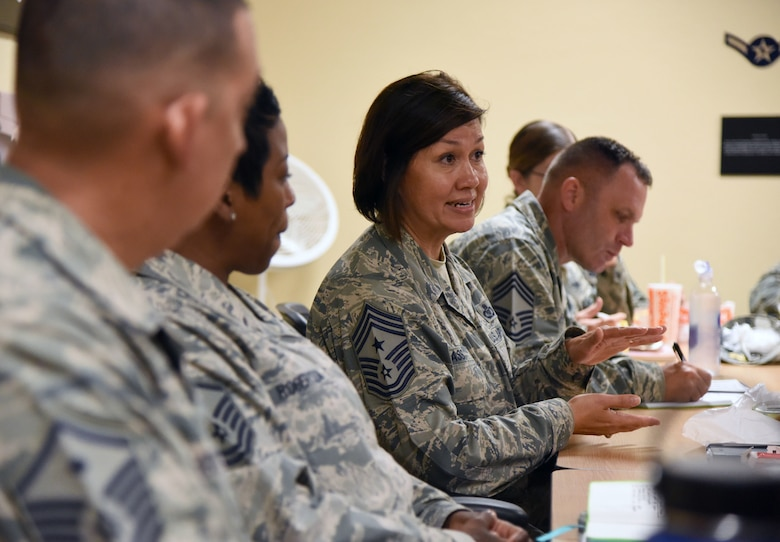 Chief Master Sgt. JoAnne Bass, 2nd Air Force command chief, engages in conversation with Airmen at the Keesler Professional Development Center during an immersion tour on Keesler Air Force Base, Mississippi, Aug. 23, 2018. The purpose of the tour was to become more familiar with Keesler's mission. (U.S. Air Force photo by Kemberly Groue)