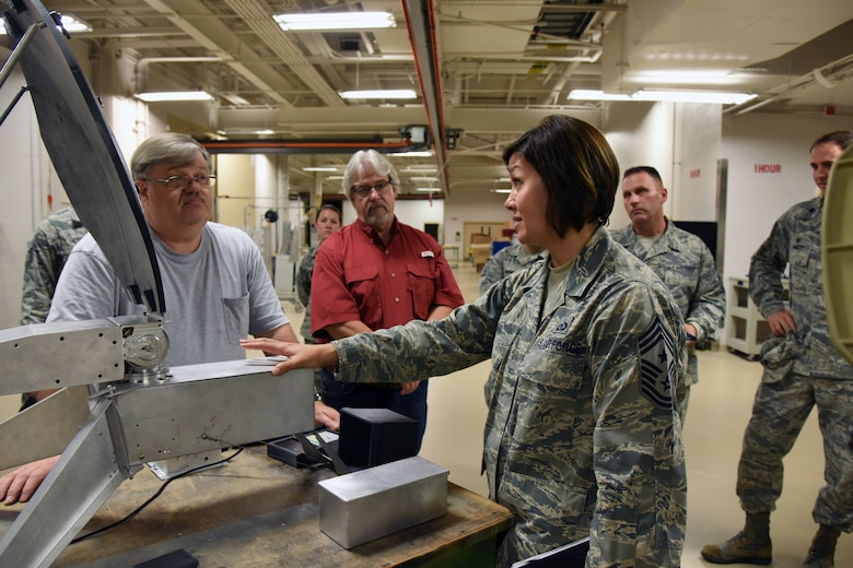Chief Master Sgt. JoAnne Bass, 2nd Air Force command chief, receives a briefing on the Trainer Development Center's capabilities during an immersion tour on Keesler Air Force Base, Mississippi, Aug. 23, 2018. Bass's one-day tour also included the Keesler Medical Center, 81st Mission Support Group and Wing Staff Agency. (U.S. Air Force photo by Kemberly Groue)