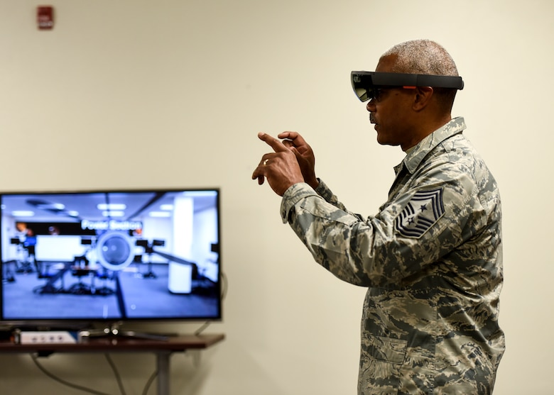 CMSgt. Jack Johnson Jr. interacts with a virtual engine at the Digital Design Lab at Sheppard AFB