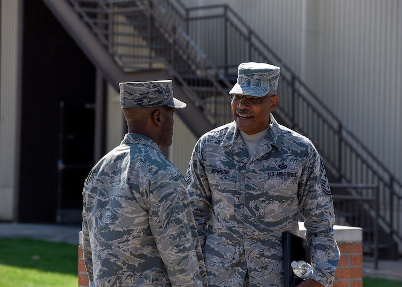 Brig. Gen. Ronald Jolly welcomes CMSgt. Jack Johnson in front of the Airman Leadership School.