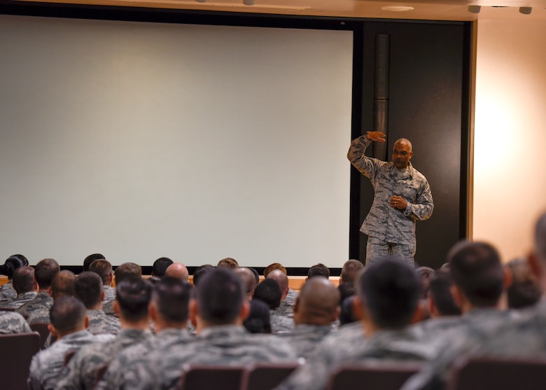 CMSgt. Jack Johnson gives a speech in front of a room filled with future NCOs.