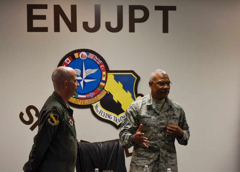 Col. Russell Driggers stands by CMSgt. Jack Johnson Jr. during his visit to the 80th Flying Wing to check up on the EJJPT program run by NATO.
