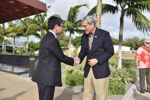 Taro Kono, Foreign Minister of Japan, right, is briefed by a forensic anthropologist with the Defense POW/MIA Accounting Agency (DPAA) during a tour at Joint Base Pearl Harbor-Hickam, Hawaii, Aug. 22, 2018. Kono and other delegates visited the agency's facility for an orientation briefing of the identification processes of unknown U.S. service members. The mission of DPAA is to provide the fullest possible accounting for our missing personnel to their families and the nation. (U.S. Air Force photo by Tech. Sgt. Kathrine Dodd)