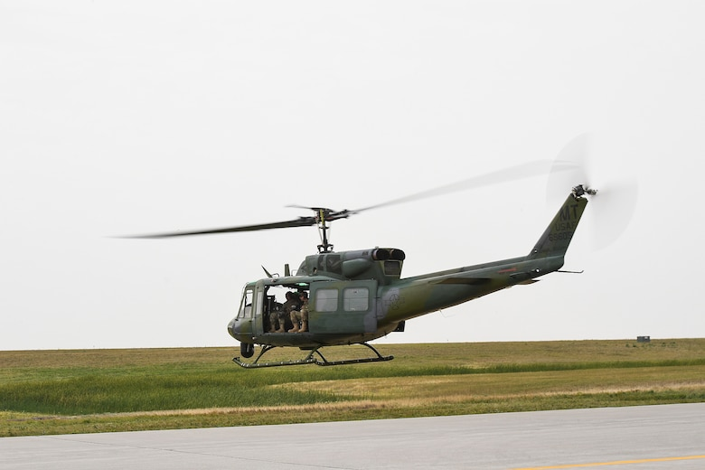 5th SFS MWDs fly with 54th Helicopter Squadron