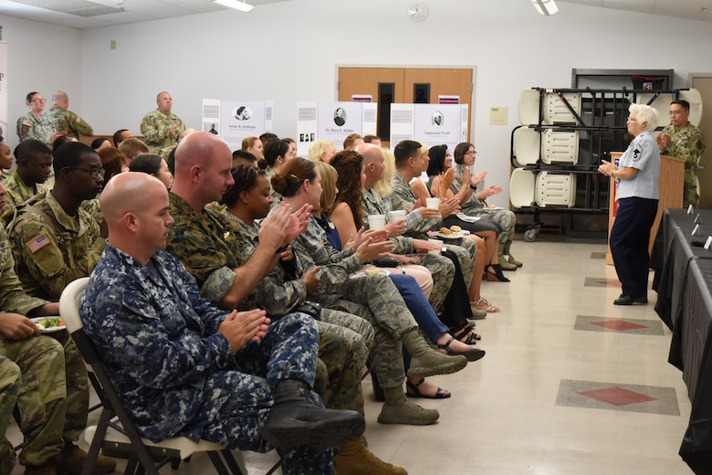 Goodfellow service members welcome retired U.S. Air Force Chief Master Sgt. Kathleen Prince back to Goodfellow for a speech about her time in the military for Women's Equality Day at the Taylor Chapel on Goodfellow Air Force Base, Texas, Aug. 24, 2018. Prince was stationed at Goodfellow several times during her career with the Air Force and now teaches junior ROTC cadets at Central High School in San Angelo. (U.S. Air Force photo by Airman 1st Class Seraiah Hines/Released)