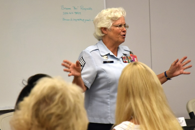 Retired U.S. Air Force Chief Master Sgt. Kathleen Prince, Central High School Junior ROTC instructor, reminisces about her time with the Women in the Air Force program before being allowed to join the regular Air Force during her speech for Women's Equality day at the Taylor Chapel on Goodfellow Air Force Base, Texas, Aug. 24, 2018. Prince shared moments from her career and how the opportunities for women have increased since she joined in 1975. (U.S. Air Force photo by Airman 1st Class Seraiah Hines/Released)