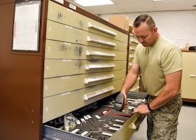 Master Sgt. Armando Valencia, a powered support system technician with the 162nd Maintenance Squadron Aerospace Ground Equipment Flight, issues a tool by scanning its barcode using the AGE TC Max tool accountability program. The program uses technology to keep better track of tools and equipment.