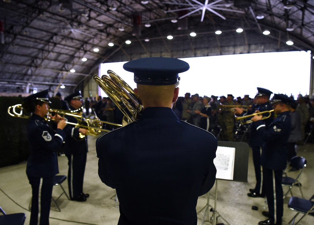 The Pacific Air Forces Band plays as Gen. Vincent K. Brooks, Commander, United Nations Command/Combined Forces Command/United States Forces Korea, presides over the Seventh Air Force change of command ceremony today in which Lt. Gen. Thomas W. Bergeson relinquished command to Lt. Gen. Kenneth S. Wilsbach at Osan Air Base, Republic of Korea. (U.S. Air Force Photo By Staff Sgt. Sergio Gamboa)