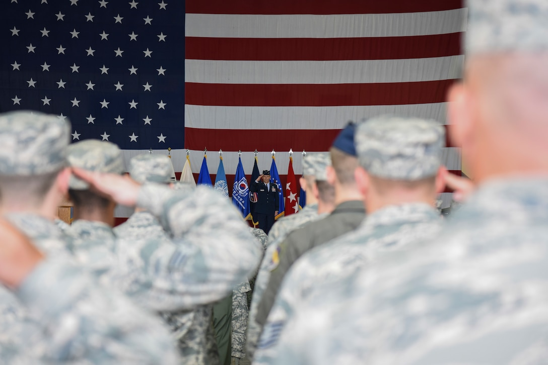 Lt. Gen. Kenneth S. Wilsbach, Deputy Commander, U.S. Forces Korea/ Commander, Air Component Command, United Nations Command/Air Component Command, Combined Forces Command/7th AF, Pacific Air Forces, Osan AB, Republic of Korea, receives his first salute from the men and women of his command during a change of command ceremony at Osan Air Base, Republic of Korea Aug 27, 2018. (U.S. Photo by Senior Airman Savannah L. Waters)