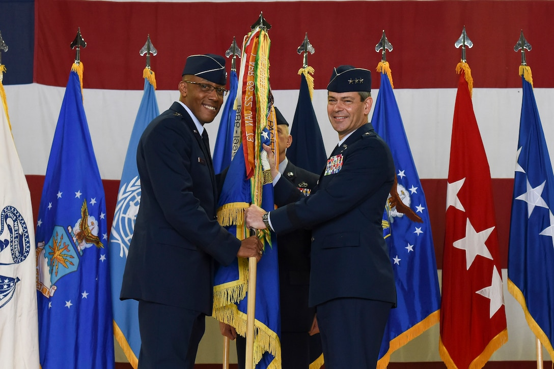 Lt. Gen. Kenneth S. Wilsbach, receives the guideon from Gen. CQ Brown, Jr., Pacific Air Forces commander, as he assumes command and becomes the Deputy Commander, U.S. Forces Korea/ Commander, Air Component Command, United Nations Command/Air Component Command, Combined Forces Command/7th AF, Pacific Air Forces, Osan AB, Republic of Korea (U.S. Photo by Senior Airman Savannah L. Waters)