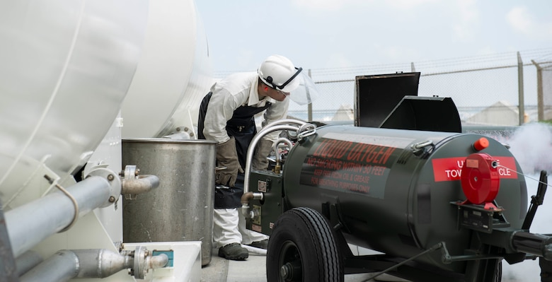 U.S. Air Force Senior Airman Michael Hall, 18th Logistics Readiness Squadron cryogenic production operator, fill a cart with liquid oxygen July 27, 2018, at Kadena Air Base, Japan. The production plant has been operational for nearly a year and has been very successful.