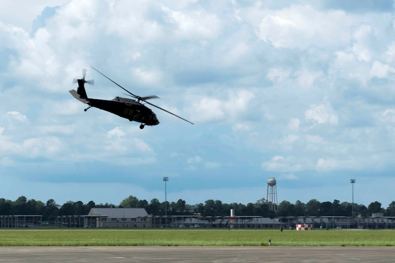 U.S. Air Force Airmen assigned to the 20th Civil Engineer Squadron explosive ordnance disposal flight fly on a UH-60 Black Hawk helicopter assigned to McEntire Joint National Guard Base at Shaw Air Force Base, S.C., Aug. 20, 2018.