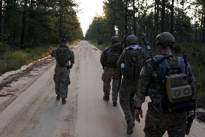 U.S. Air Force Airmen assigned to the 20th Civil Engineer Squadron explosive ordnance disposal flight ruck march at McCrady Army National Guard Base training area near Columbia, S.C., Aug. 23, 2018.