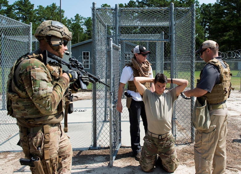 U.S. Air Force Airmen assigned to the 20th Civil Engineer Squadron simulate a prisoner capture at McCrady Army National Guard Base training area near Columbia, S.C., Aug. 23, 2018.