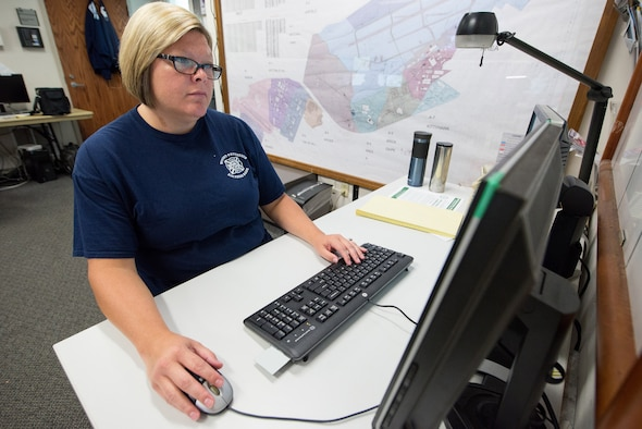 Stephanie Nevin, Wright-Patterson Air Force Base Fire Department emergency vehicle dispatcher, works on GeoBase, a detailed online map that uses a graphical user interface and overlays to allow first responders to see detailed information all around the base August 27, 2018.