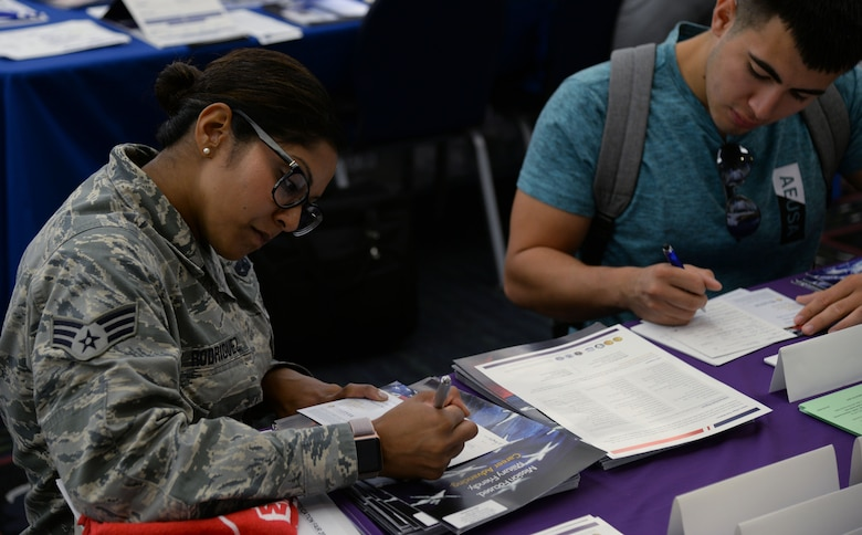 Senior Airman Aisha Rodriguez, 932nd Logistics Readiness Flight, fills out a contact sheet provided by one of the booths at the Education Fair, Aug. 16, 2018 at the Scott Air Force Base on Scott AFB, Ill. The 375th Force Support Squadron held an education fair to give service members an opportunity to compare degree programs, admissions requirements, delivery formats, student services, and costs to select a program that best meets their unique circumstances.