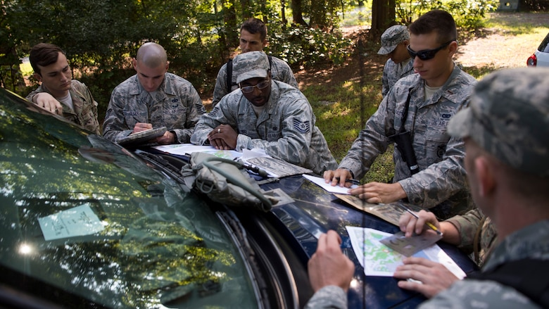 U.S. Air Force security forces Airmen gather prior the land navigation test, during Air Combat Command's Defender Challenge team selection at Joint Base Langley-Eustis, Virginia, Aug. 23, 2018.