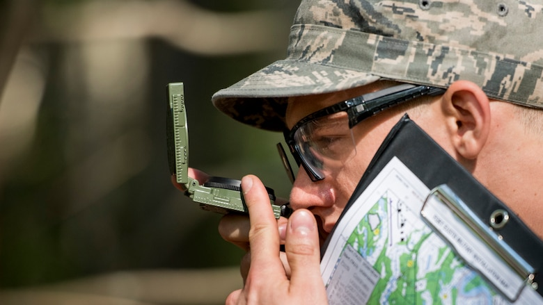 U.S. Air Force Staff Sgt. Anthony Zygmunt, 7th Reconnaissance Squadron alarm monitor, navigates land during Air Combat Command's Defender Challenge team selection at Joint Base Langley-Eustis, Virginia, Aug. 23, 2018.