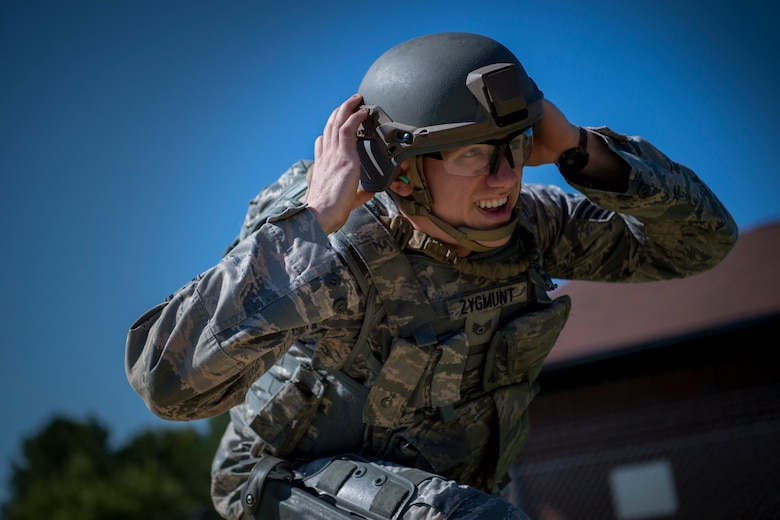 U.S. Air Force Staff Sgt. Anthony Zygmunt, 7th Reconnaissance Squadron alarm monitor, performs physical exercises prior to firing during Air Combat Command's Defender Challenge team selection at Joint Base Langley-Eustis, Virginia, Aug. 24, 2018.