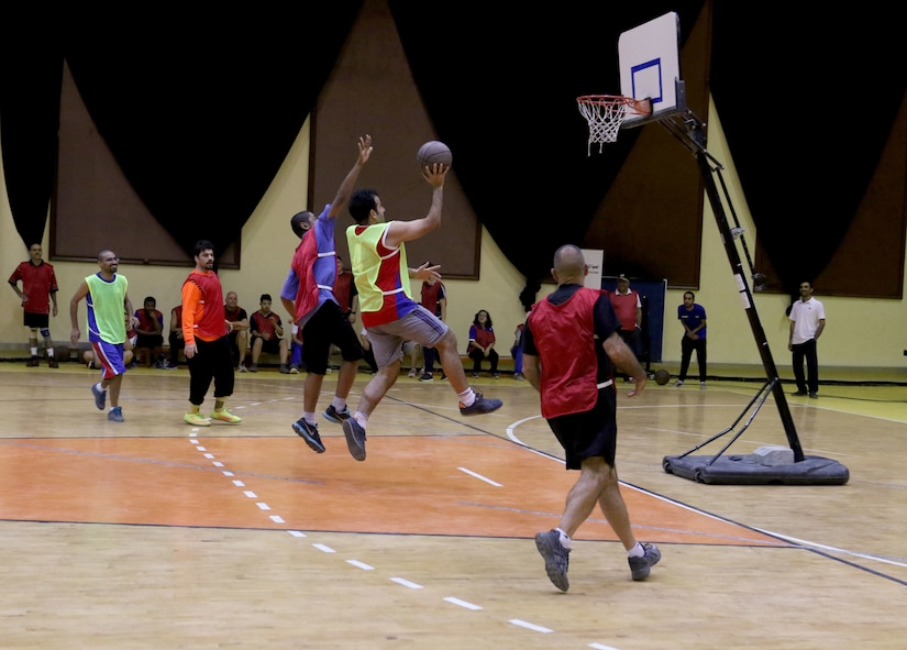 A Special Olympics athlete drives the lane during the basketball portion of the competition at Aridiyah Youth Center, Kuwait. The organization teamed up with Soldiers from Task Force Spartan for the event.
