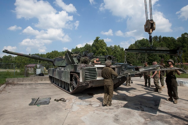 Marines with 1st Tank Battalion, 2nd Tank Bn., and 4th Tank Bn. provide maintenance to an M1A1 Abrams tank in preparation for the 15th annual Tiger Competition, Aug. 27, 2018 in Fort Knox, Kentucky.