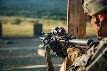 A U.S. Marine with Black Sea Rotational Force 18.1 conducts a tactical reload while executing an advanced portion of a Combat Marksmanship Program range during Exercise Platinum Lion 18.