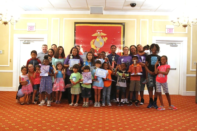 Several military families and their children kept their brains energized over the summer by reading dozens of books as part of the annual summer reading program. More than 100 readers ranging from pre-school to adults completed more than 83,000 minutes of reading. And to celebrate the feat, the Marine Corps Community Services' Marine and Family Program, held a special awards ceremony for the participants, August 25.