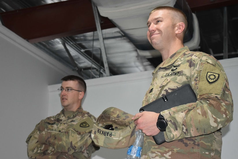 U.S. Army Capt. William Parker and U.S. Army Staff Sgt. Bryan Parker, activated members of the Kentucky Army National Guard 613th Engineering Facilities Detachment, serve as contract officer representatives for Area Support Group-Kuwait Directorate of Public Works at Camp Arifjan, Kuwait, August 6, 2018. The Army's greatest asset is the best people our Nation has to offer.