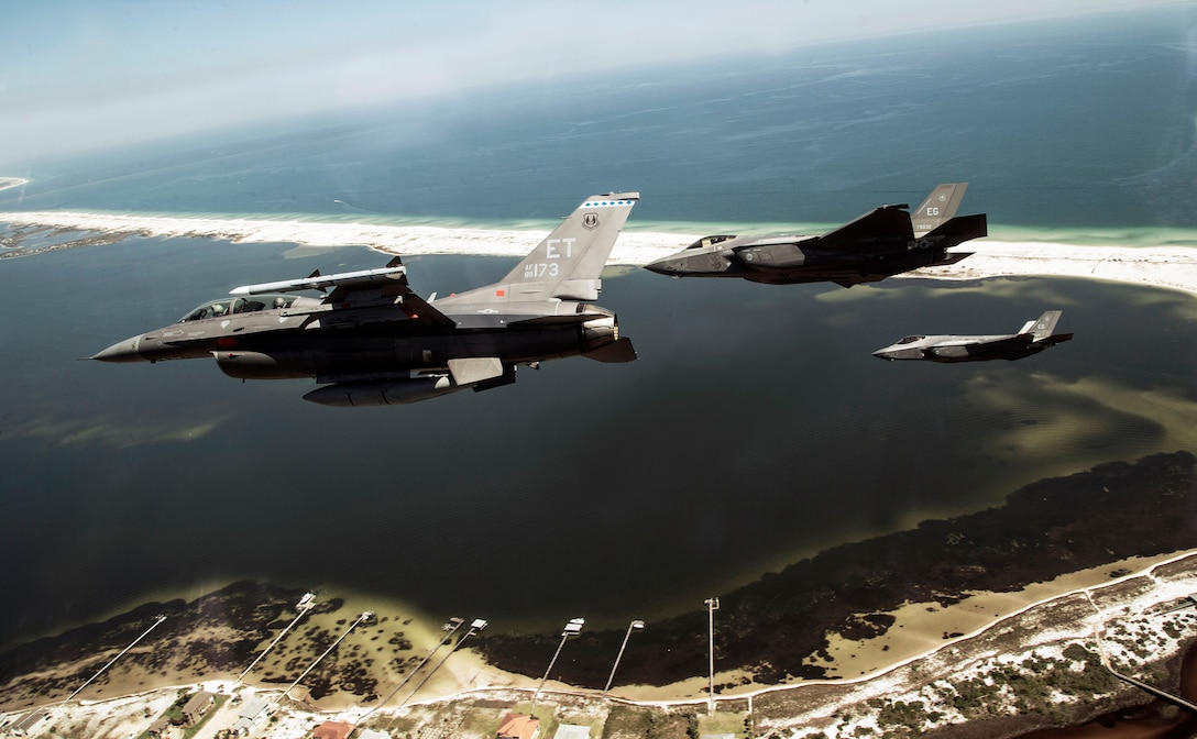 Aircrew from the 40th Flight Test Squadron and the 33rd Fighter Wing perform a mixed aircraft flyover near Pensacola Naval Station, Florida.