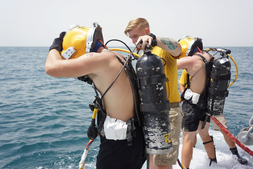 Soldiers assigned to the 74th Engineer Dive Detachment prepare to enter the water in the Arabian Gulf, July 13, 2018.