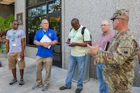 Several participants receive a briefing while walking through Detroit during the 2018 DoD Support of Civil Authorities (DSCA)/Chemical, Biological, Radiological and Nuclear (CBRN) Dense Urban Terrain Training Tactical Exercise Without Troops exercise on Aug. 23. The particpants were among some of the 150 participants from more than 50 organizations of the interagency, to include local, state, federal and international partners. The attendees studied the layout of the city and discussed the challenges of conducting urban search and rescue and other DSCA rescue efforts in a city such as Detroit, which ranks third in the state for population density. The training was held by the 46th Military Police Command, Michigan Army National Guard, Command and Control CBRN Response Element – Bravo and included other key training stops within the city landscape. Members of Joint Task Force Civil Support also participated in the exercise. (Official DoD photo by Mass Communication Specialist 3rd Class Michael Redd/released)