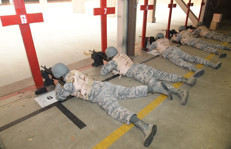 Airmen lay in prone support position during an M4 rifle qualifying course