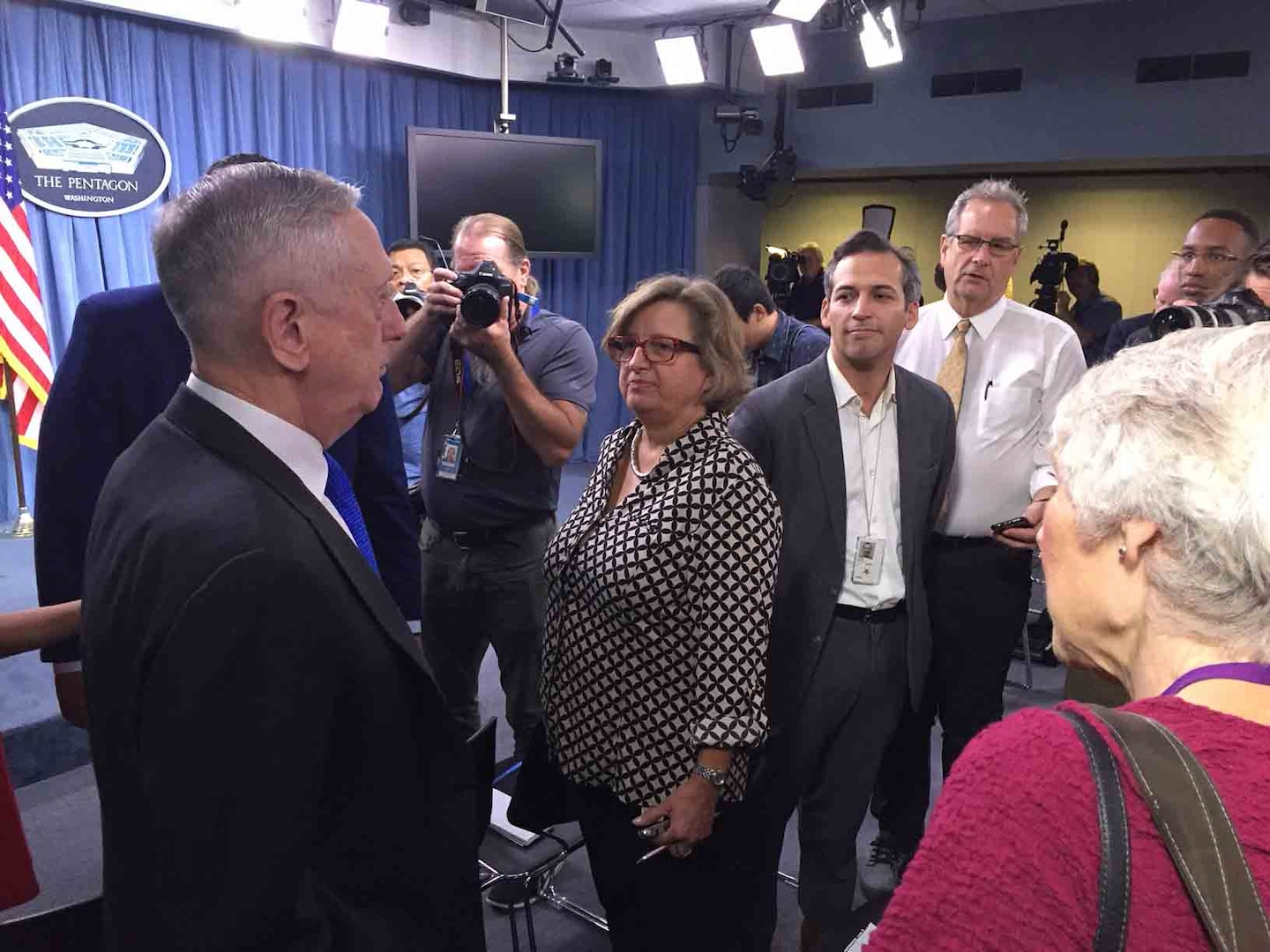 Defense Secretary greets reporters before news conference.