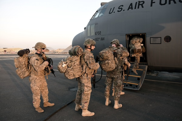 U.S. service members board a C-130H at an undisclosed location in Southwest Asia. The 386th moved an average of nearly 8,000 passengers a month throughout the U.S. Central Command area of responsibility in support of Operation Inherent Resolve.