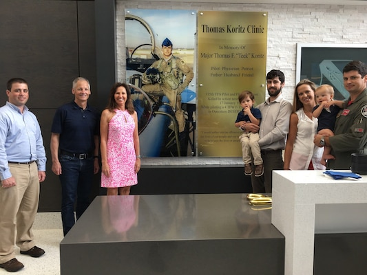 "The Koritz family shown in front of the memorial wall at the new Thomas Koritz Clinic, Seymour Johnson Air Force Base, North Carolina. The U.S. Army Corps of Engineers oversaw the construction of the $55 million facility which was named in honor of Air Force Maj. Thomas F. ""Teek"" Koritz, a flight surgeon and pilot killed in a bombing mission during the Gulf War. (Courtesy photo)"