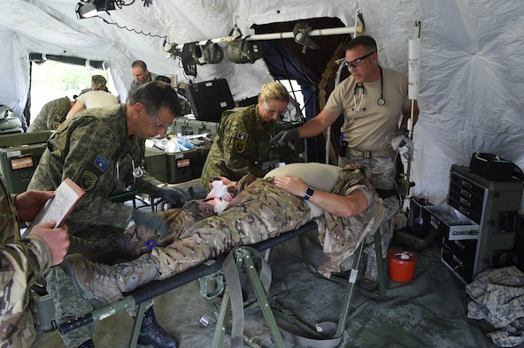 132d MDG Airmen along with Kosovo Security Forces (KSF) medics administer initial treatment August 20, 2018, at Camp Dodge in Johnston, Iowa. The medical team participated in an intensive, two-week, multi-dimensional, medical training course and field training exercise. (U.S. Air National Guard photo by Senior Master Sgt. Robert Shepherd)