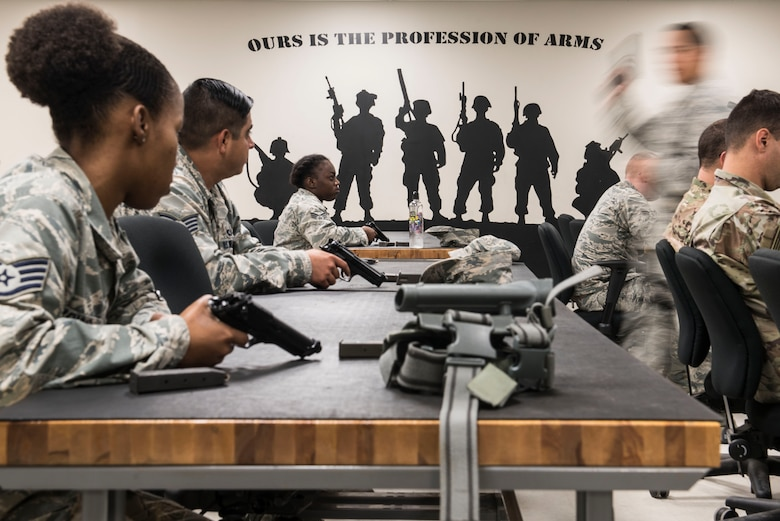 U.S. Air Force Staff Sgt. Joseph Flores, 20th Security Forces Squadron combat arms instructor, walks around a classroom while teaching at Shaw Air Force Base, S.C., Aug. 22, 2018.