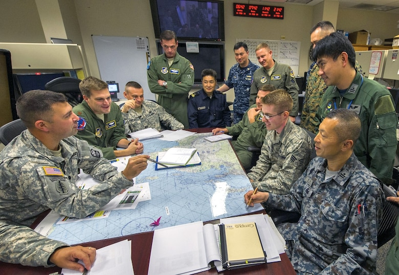 U.S. and international military personnel engage in wargaming and operations planning. (U.S. Air Force/Nathan Allen)