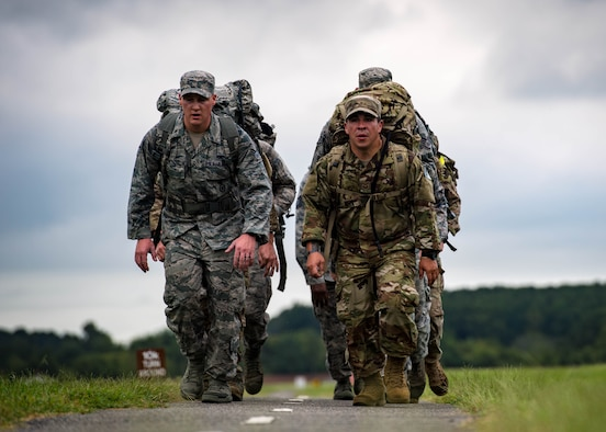 U.S. Air Force Airmen ruck march during Air Combat Command's Defender Challenge team selection at Joint Base Langley-Eustis, Virginia, August 20, 2018.