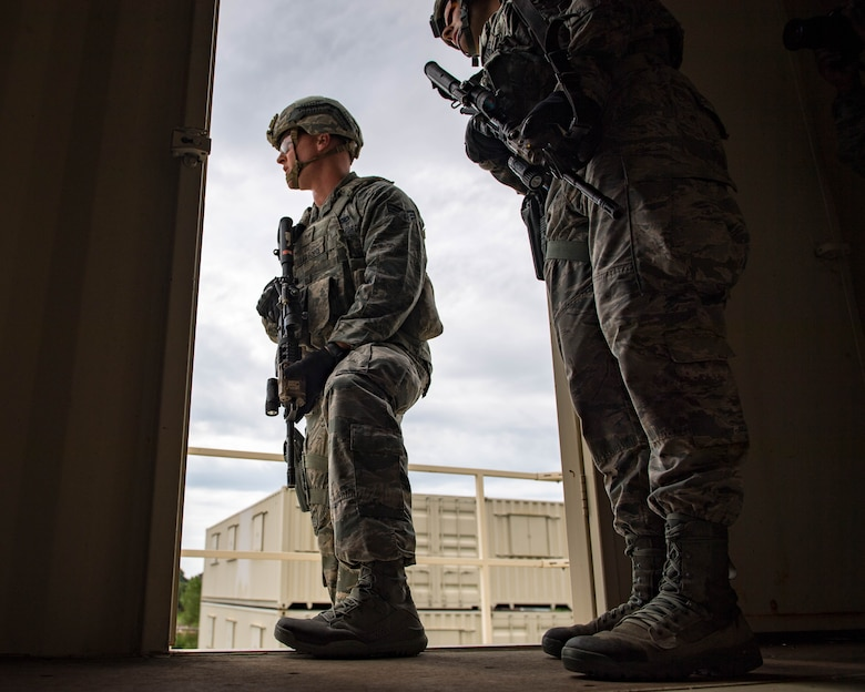 U.S. Air Force Senior Airman Aaron Lee, 9th Security Forces Squadron patrolman, and Airman 1st Class Jacob D'Agostino, 633rd Security Forces Squadron response force leader, clear a building during Air Combat Command's Defender Challenge team selection at Joint Base Langley-Eustis, Virginia, August 20, 2018.