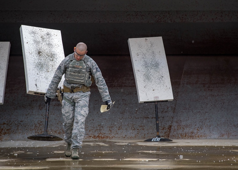 U.S. Air Force Tech. Sgt. Matthew Heiser, 49th Security Forces Squadron flight chief, repositions a target during Air Combat Command's Defender Challenge team selection at Joint Base Langley-Eustis, Virginia, August 20, 2018.