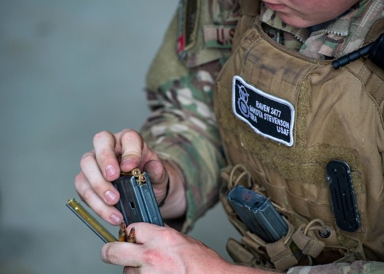 U.S. Air Force Senior Airman Dakota Stevenson, 55th Security Forces Squadron fly away security, loads a magazine during Air Combat Command's Defender Challenge team selection at Joint Base Langley-Eustis, Virginia, August 20, 2018.