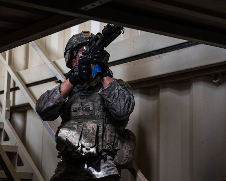 U.S. Air Force Senior Airman Aaron Lee, 9th Security Forces Squadron patrolman, clears a building during Air Combat Command's Defender Challenge team selection at Joint Base Langley-Eustis, Virginia, August 21, 2018.