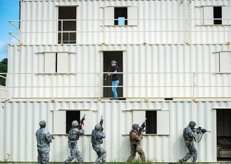U.S. Air Force Airmen perform clear a building during Air Combat Command's Defender Challenge team selection at Joint Base Langley-Eustis, Virginia, August 21, 2018.
