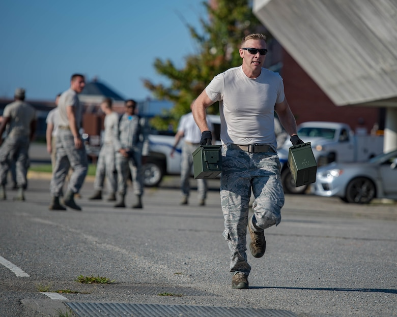 U.S. Air Force Staff Sgt. Aaron Vanley, 633rd Security Forces Squadron base defense operations center controller, carries ammunition cans during Air Combat Command's Defender Challenge team selection at Joint Base Langley-Eustis, Virginia, August 24, 2018.