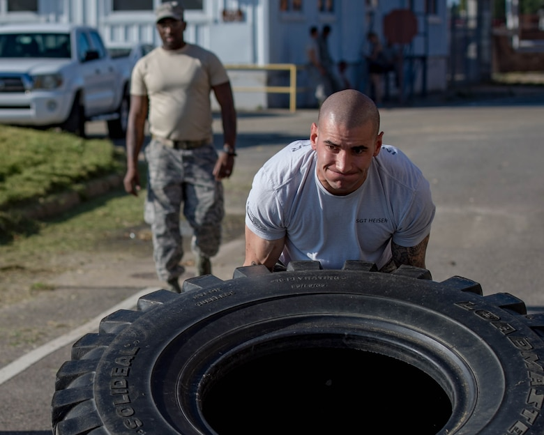 U.S. Air Force Tech. Sgt. Matthew Heiser, 49th Security Forces Squadron flight chief, performs tire flips during Air Combat Command's Defender Challenge team selection at Joint Base Langley-Eustis, Virginia, August 24, 2018.