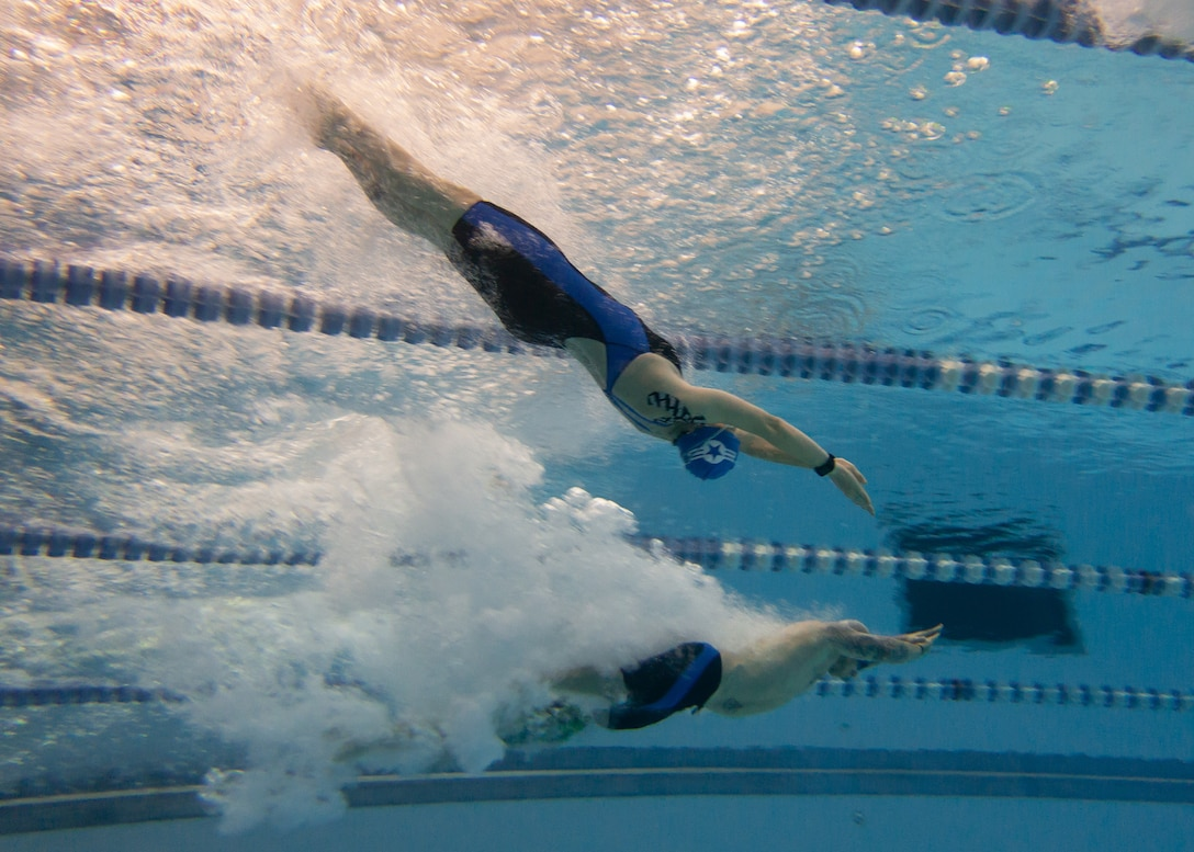 Master Sgt. Lisa Goad, Team Air Force athlete, completes a backstroke dive at the 2018 Department of Defense Warrior Games at the U.S. Air Force Academy in Colorado Springs, Colo. on June 4. The Warrior Games are a Paralympic style athletic competition where Wounded Warriors from all service branches compete against each other. (Photo by Master Sgt. David Long)
