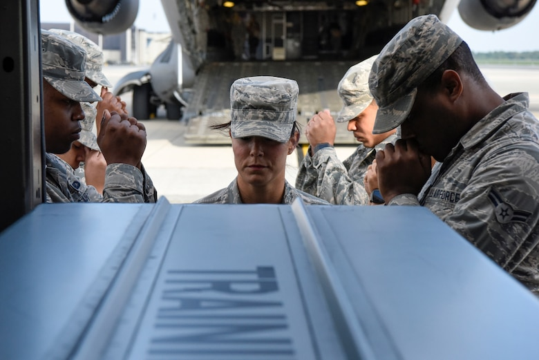 United States Air Force active duty and Reserve Airmen practice their movements during dignified transfer training for Air Force Mortuary Affairs Operations Aug. 23, 2018, at Dover Air Force Base, Del. A dignified transfer is the process by which, upon the return from the theater of operations to the United States, the remains of fallen military members are transferred from the aircraft to a waiting vehicle and then to the port mortuary. (U.S. Air Force photo by Airman 1st Class Zoe M. Wockenfuss)